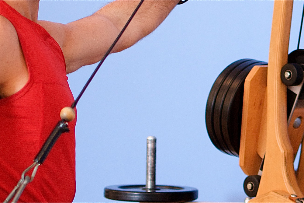Gyrotonic weighted-pulley machine